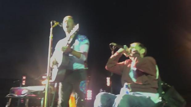 Man in wheelchair crowdsurfs to join Chris Martin at Coldplay concert