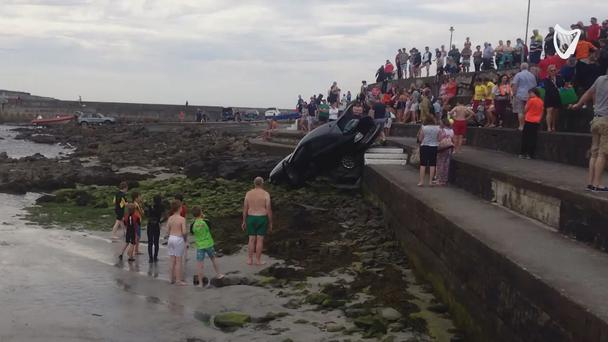 'Runaway' auto rolls down steps towards the sea at Kilkee beach