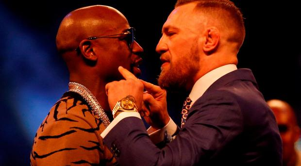 Boxing - Floyd Mayweather & Conor McGregor square up during a press conference Photo: Reuters/Paul Childs