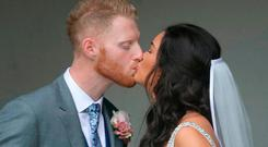 England all-rounder Ben Stokes kisses his newly married wife Clare, out side St Mary the Virgin, East Brent, Somerset. PRESS ASSOCIATION Photo. Picture date: Saturday October 14, 2017. See PA story SPORT Stokes. Photo credit should read: Steve Parsons/PA Wire