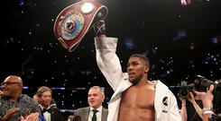 Anthony Joshua celebrates with the WBO Heavyweight belt after victory over Joseph Parker in their WBA, IBF, WBO and IBO Heavyweight Championship contest at the Principality Stadium, Cardiff. PRESS ASSOCIATION Photo. Picture date: Friday March 30, 2018. See PA story BOXING Cardiff. Photo credit should read: Nick Potts/PA Wire