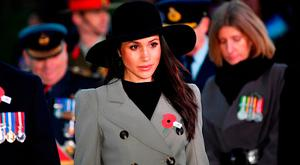LONDON, ENGLAND - APRIL 25: Prince Harry and Meghan Markle attend the Dawn Service at Wellington Arch to commemorate Anzac Day on April 25, 2018 in London, United Kingdom. (Photo by Toby Melville - WPA Pool/Getty Images)