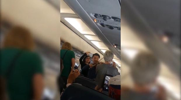 Video: Professional violinist offers calming performance for delayed flight passengers