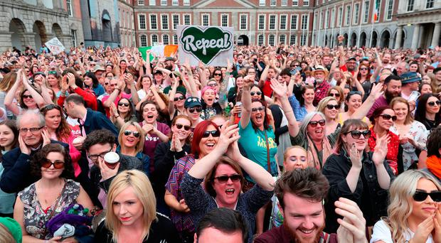 Members of the public celebrate at Dublin Castle after the results of the referendum on the 8th Amendment Photo: Niall Carson/PA Wire