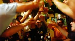 STRASBOURG, FRANCE - MAY 18: Italian students from the Primo Levi Technical Institute of Vignola in the Modena Province, toast with glasses of beer in a pub during a school trip to Strasbourg, France to visit the European Parliament on May 18, 2004. School trips can be a sort of initiation trip for teenagers, where they are introduced for the first time to alcohol and drugs. Many times they don't sleep for the whole trip. The trips often allow the students to get to know each other better. If one is considered