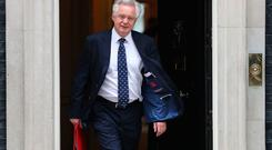 (FILES) This June 5, 2018 file photo shows Britain's Secretary of State for Exiting the European Union (Brexit Minister) David Davis leaving 10 Downing Street in central London after attending the weekly cabinet meeting. Britain's Brexit minister David Davis has resigned two days after the cabinet approved a plan to keep strong economic ties with the European Union after leaving the bloc, British media reported on Sunday, July 8, 2018. Davis, who was appointed two years ago to head up the newly-created Department for Exiting the European Union, had reportedly threatened to quit several times over Prime Minister Theresa May's stance in Brexit talks. / AFP PHOTO / Daniel LEAL-OLIVASDANIEL LEAL-OLIVAS/AFP/Getty Images
