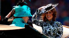 Princess Eugenie of York (right), Anne Princess Royal (left) and Princess Beatrice of York (hidden) arriving at the racecourse during day three of Royal Ascot at Ascot Racecourse