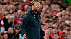 Liverpool's German manager Jurgen Klopp reacts during the English League Cup third round football match between Liverpool and Chelsea at Anfield in Liverpool, north west England on September 26, 2018. (Photo by Paul ELLIS / AFP) / RESTRICTED TO EDITORIAL USE. No use with unauthorized audio, video, data, fixture lists, club/league logos or 'live' services. Online in-match use limited to 120 images. An additional 40 images may be used in extra time. No video emulation. Social media in-match use limited to 120 images. An additional 40 images may be used in extra time. No use in betting publications, games or single club/league/player publications. / PAUL ELLIS/AFP/Getty Images