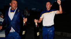 Golf - 2018 Ryder Cup at Le Golf National - Guyancourt, France - September 30, 2018. Team Europe's Ian Poulter and Rory McIlroy celebrate with champagne after winning the Ryder Cup REUTERS/Paul Childs
