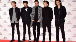 File photo dated 11/12/14 of (left to right) Niall Horan, Zayn Malik, Liam Payne, Louis Tomlinson and Harry Styles of One Direction. Figures from Deezer have shown that One Direction's final single together is their most streamed song of 2018. History is the most streamed song of the year so far, followed by What Makes You Beautiful, Drag Me Down, Steal My Girl and Little Things.