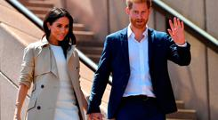 Britain's Prince Harry and his wife Meghan walk down the stairs of Sydneys iconic Opera House to meet people in Sydney on October 16, 2018. - Prince Harry and Meghan have made their first appearances since announcing they are expecting a baby, kicking off a high-profile Pacific trip with a photo in front of Sydney's dazzling Opera House and posing with koalas. (Photo by SAEED KHAN / AFP)SAEED KHAN/AFP/Getty Images