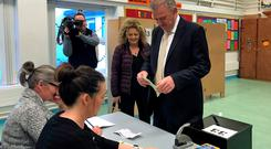 Irish presidential candidate Peter Casey casts his vote at the polling station in Greencastle National School, Co Donegal, as the country goes to the polls to vote in the Irish presidential election. Rebecca Black/PA Wire