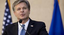 FILE - In this Sept. 28, 2017, file photo, FBI Director Chris Wray speaks at his installation ceremony at the FBI Building in Washington. Wray is dismissing Russia President Vladimir Putin's denial of election meddling. Wray said July 18, 2018, that he stands behind the U.S. intelligence agencies' assessment that Moscow did intervene. And he says Russia continues to use fake news and propaganda to stir up divisiveness in American society. (AP Photo/Andrew Harnik, File)
