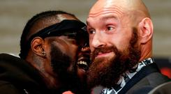 Boxers Deontay Wilder, left, and Tyson Fury exchange words as they face each other at a news conference in Los Angeles, Wednesday, Nov. 28, 2018, ahead of their heavyweight world championship boxing match in Los Angeles on Dec. 1, at Staples Center. (AP Photo/Damian Dovarganes)