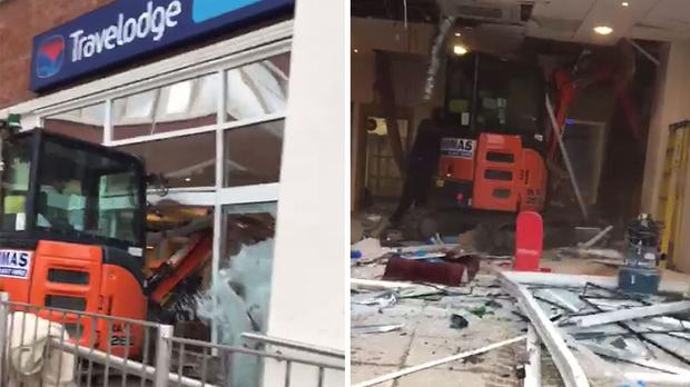 Digger drives into hotel during building site rampage