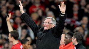 Manchester United manager Sir Alex Ferguson celebrates winning the league title after the final whistle. Photo: PA