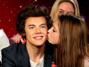 A fan kisses a waxwork of One Direction's Harry Styles at Madame Tussauds. Photo: Getty Images
