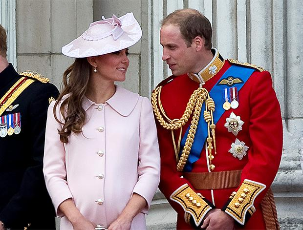 Britain's Prince William (R) and his pregnant wife Catherine, Duchess of Cambridge