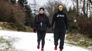 David Fallon and Jennie Molloy, from Baldonnel out for a walk in a snow covered Slade Valley in Co Dublin