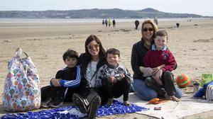 Jenny Collins and Jaime Egan from Malahide with their children, George (9), Douglas (5) and Sean (5) pictured enjoying the fine weather on Portmarnock Beach yesterday afternoon. Photo: Colin Keegan, Collins Dublin