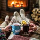 Warming and relaxing near fireplace. Stock photo