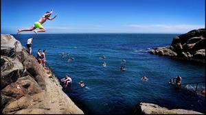 Making a splash: Bathers enjoy the recent sunny weather at the Forty Foot in Sandycove, Dublin. Photo: steve humphreys