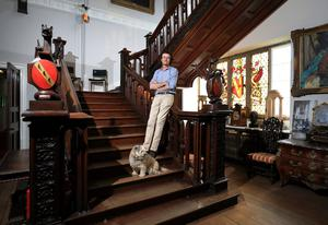 Lord Anthony Ardee pictured with one of his dogs Trudy on the main staircase at Killruddery House in Bray Co Wicklow. Picture:Frank McGrath