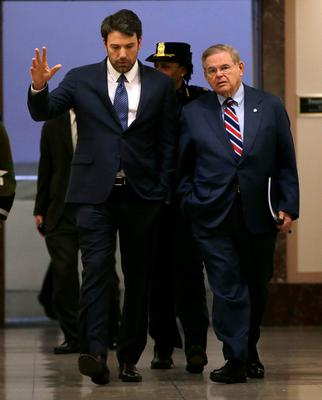 Actor, writer and director Ben Affleck (L) walks with Senator Robert Menendez (D-NJ)(R) before testifying at the Senate Foreign Relations Committee on Capitol Hill in Washington February 26, 2014. Menendez is the chairman of the committee.  REUTERS/Gary Cameron  (UNITED STATES - Tags: POLITICS ENTERTAINMENT)