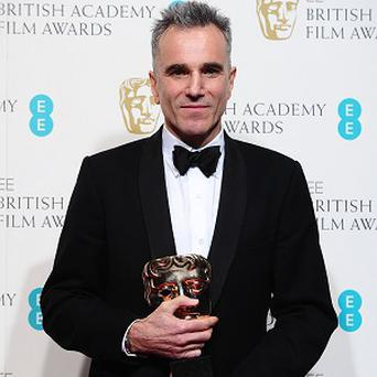 Daniel Day-Lewis with the award for Best Leading Actor for 'Lincoln', in the press room for the 2013 British Academy Film Awards at the Royal Opera House, Bow Street, London. PRESS ASSOCIATION Photo. Picture date: Sunday February 10, 2013. See PA story SHOWBIZ Baftas. Photo credit should read: Ian West/PA Wire