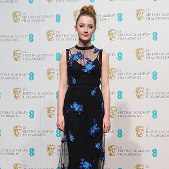Saoirse Ronan in the press room for the 2013 British Academy Film Awards at the Royal Opera House, Bow Street, London. PRESS ASSOCIATION Photo. Picture date: Sunday February 10, 2013. See PA story SHOWBIZ Baftas. Photo credit should read: Ian West/PA Wire