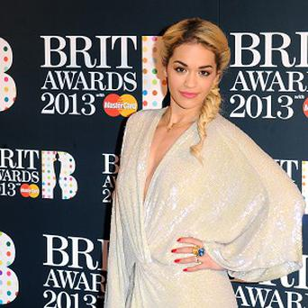 Rita Ora arrives at the Brit Awards 2013 nominations launch at the Savoy Hotel in London. PRESS ASSOCIATION Photo. Picture date: Thursday January 10, 2013. Photo credit should read: Ian West/PA Wire