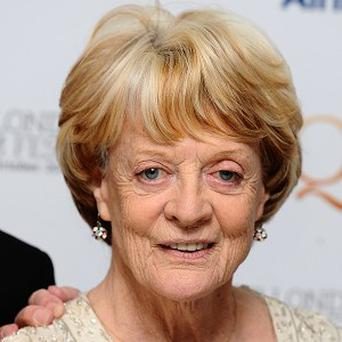File photo dated 15/10/2012 of Dame Maggie Smith, who has dismissed reports she was at the centre of a heart scare. PRESS ASSOCIATION Photo. Issue date: Sunday November 4, 2012. Her spokeswoman said of the award-winning actress: