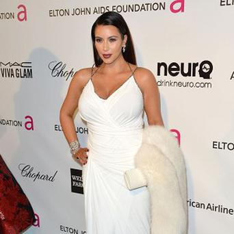 Kim Kardashian has posed with her beau Kanye West