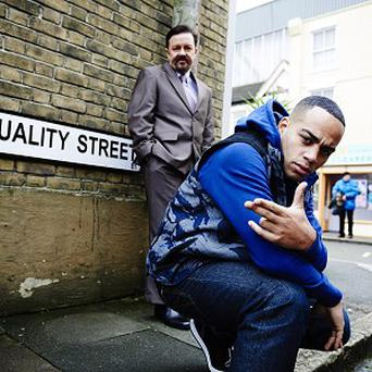 Undated BBC One handout of Ricky Gervais as David Brent and Doc Brown as rapper Dom Johnson who are returning to our screens for a one off Comic Relief edition of The Office. PRESS ASSOCIATION Photo. Issue date: Thursday February 28, 2013. See PA story SHOWBIZ Gervais. Photo credit should read: BBC One/PA Wire NOTE TO EDITORS: This handout photo may only be used in for editorial reporting purposes for the contemporaneous illustration of events, things or the people in the image or facts mentioned in the caption. Reuse of the picture may require further permission from the copyright holder.