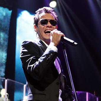 Singer Marc Anthony performs during a concert at the Barclays Center, Friday, Feb. 15, 2013, in New York. (Photo by Jason DeCrow/Invision/AP)