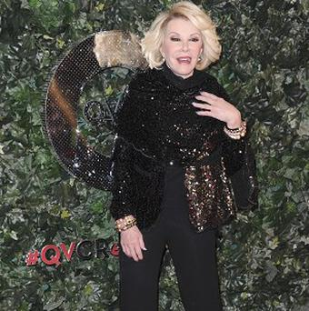 Joan Rivers arrives at the QVC Red Carpet Style at the Four Seasons Hotel on Friday, Feb. 22, 2013 in Los Angeles. (Photo by Richard Shotwell/Invision/AP)