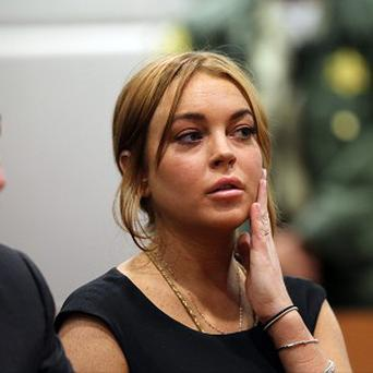 Lindsay Lohan faces charges she lied to police about her role in a car crash last June