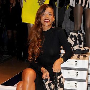 Rihanna at the River Island store in Oxford Street to promote her new fashion line
