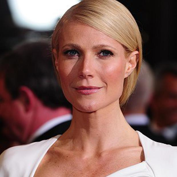Gwyneth Paltrow opening a blow dry bar with her personal trainer