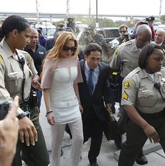 Lindsay Lohan was showered with gold glitter as she arrived late for court