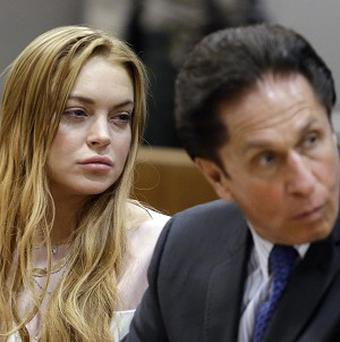 Actress Lindsay Lohan, left, and her lawyer Mark Heller appear at a hearing in Los Angeles Superior Court (AP)