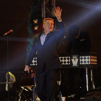 Madness perform outside BBC Television Centre in Shepherd's Bush, west London, to the mark the end of broadcasting from the building