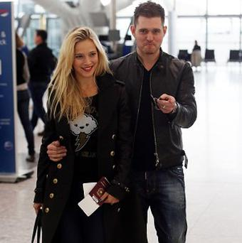 Michael Buble and his wife Luisana Lopilato are hoping their unborn child will be a soccer star