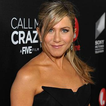 Jennifer Aniston has different ideas to Justin on the type of wedding they want