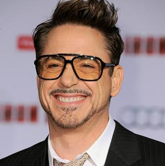 Robert Downey Jr was all smiles at the Iron Man 3 premiere in LA