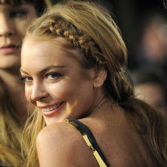 Lindsay Lohan has checked into rehab in compliance with her court order