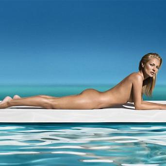Kate Moss shows off her impressive body and tan in the new ad