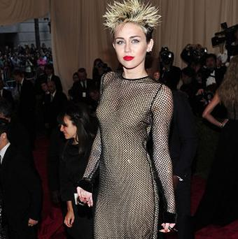 Miley Cyrus has topped Maxim's Hot 100 list