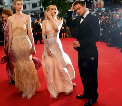 Cast members Leonardo DiCaprio (R), Carey Mulligan (C) and Elizabeth Debicki arrive on the red carpet for the screening of the film 'The Great Gatsby'