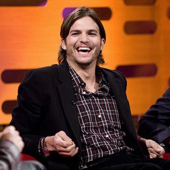 Ashton Kutcher spent time with Mila Kunis' parents in London